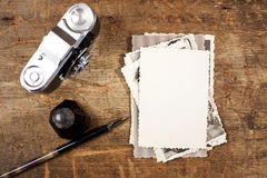 Vintage ink and  pen, old photos and camera Royalty Free Stock Images