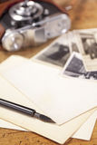 Vintage ink pen, old photos and camera Stock Photo