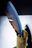 Vintage inkpot with goose-quill inside Stock Photography