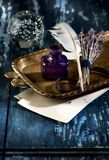 Vintage inkwell and feather quil penl. Vintage inkwell, feather quil penl and bunch lavender. Retro still life Royalty Free Stock Image