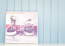 Vintage inspiring poster with old bicycle - flowerbed Stock Photos