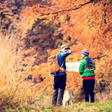 Vintage instagram couple hiking in autumn forest Royalty Free Stock Image