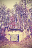 Vintage instagram filtered picture of a bunker in forest Stock Images