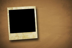 Vintage instant camera frame. Vintage instant film frame on old and rusty background with a frayed border Royalty Free Stock Photo