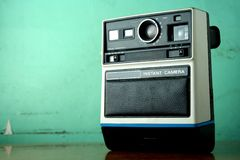 Vintage Instant Camera. Photo of an old, vintage instant camera Royalty Free Stock Photos