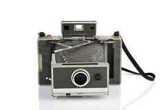 Vintage instant camera on white. Vintage instant camera and his reflection on white background Stock Photo
