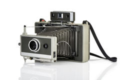 Vintage instant camera on white. Vintage instant camera and his reflection on white background Stock Photos