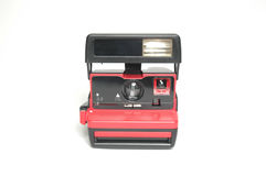 Vintage instant film camera in red color. A red-black Polaroid camera without logo. Classic camera of an age Stock Image