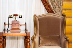 Vintage interior. Telephone and armchair Royalty Free Stock Images
