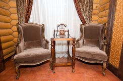 Vintage interior. Telephone and armchairs Royalty Free Stock Photography