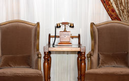 Vintage interior. Telephone and armchairs Royalty Free Stock Images