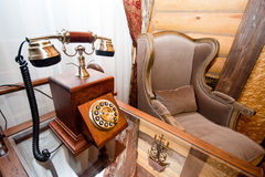 Vintage interior. Telephone and armchair Royalty Free Stock Photos