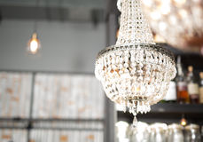 Vintage interior close up with table, chandelier and ware Royalty Free Stock Image