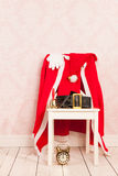 Vintage interior with clothes Santa Royalty Free Stock Photography