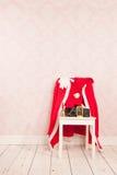 Vintage interior with clothes Santa Royalty Free Stock Image