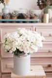 Vintage interior decoration pink pastel closet white roses in metal bucket. Royalty Free Stock Image