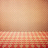 Vintage interior grunge background with checked floor and pink polka dots wall Royalty Free Stock Photo