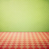Vintage interior grunge background with checked pink floor and polka dots wallpaper Stock Photos