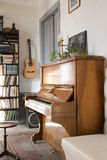 Vintage interior with piano and guitar Stock Photo