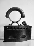 Vintage iron. Entirely of iron with wooden handle Royalty Free Stock Images