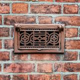 Grille in brick wall Royalty Free Stock Photography