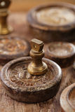 Vintage  iron and brass kitchen  weights on wood Stock Images