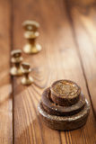 Vintage iron and brass kitchen weights on wood Royalty Free Stock Images