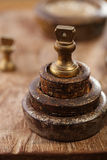 Vintage  iron and brass kitchen  weights on wood Royalty Free Stock Photography