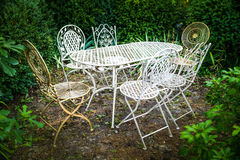 Vintage iron furniture for garden. In a green relaxing corner stock photography