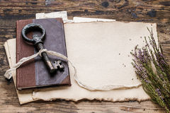 Vintage iron key, old book and secret letters Royalty Free Stock Photography