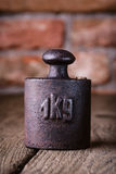 Vintage iron 1 kg weight. Stock Photos