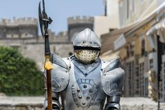 A vintage Iron Knight with pole-axe Stock Photo