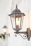Vintage iron lantern on the wal outdoor. Royalty Free Stock Image