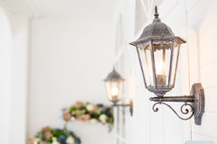 Vintage iron lantern on the wal outdoor. Royalty Free Stock Photography