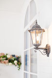 Vintage iron lantern on the wal outdoor. Stock Images