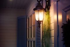 Vintage iron lantern on the wall outdoor. Exterior design elements stock image