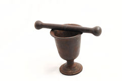 Vintage iron mortar with a pestle isolated Royalty Free Stock Photo