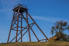 Vintage Tower Used In Mining Operations. Vintage Iron Tower With Wheel On Top Platform Used In Vintage Mining Operations Stock Photography