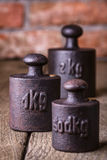 Vintage iron weights. Royalty Free Stock Images