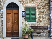 Vintage italian front door. The vintage italian front door of an old house in Tuscany Stock Photos