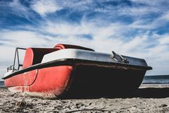 Vintage italian `pedalò`, paddle boat from the Seventies, abandoned in a Riviera Romagnola. Vintage italian `pedalò`, paddle boat from the Seventies royalty free stock photos