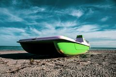 Vintage italian `pedalò`, paddle boat from the Seventies, aboadoned in a Riviera Romagnola. Vintage italian `pedalò`, paddle boat from the Seventies royalty free stock photo