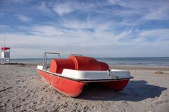 Vintage italian `pedalò`, paddle boat from the Seventies, abandoned in a Riviera Romagnola. Vintage italian `pedalò`, paddle boat from the Seventies stock image
