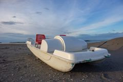 Vintage italian `pedalò`, paddle boat from the Seventies, abandoned in a Riviera Romagnola. Vintage italian `pedalò`, paddle boat from the Seventies royalty free stock images