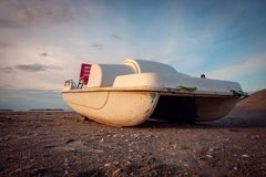 Vintage italian `pedalò`, paddle boat from the Seventies, abandoned in a Riviera Romagnola. Vintage italian `pedalò`, paddle boat from the Seventies stock photography