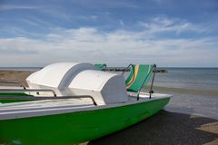 Vintage italian `pedalò`, paddle boat from the Seventies, abandoned in a Riviera Romagnola. Vintage italian `pedalò`, paddle boat from the Seventies stock photo
