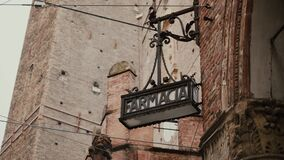 Vintage farmacia pharmacy sign from wrought iron hang in old town Bologna