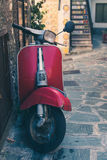 Vintage italian scooter in a alley of historic city center Stock Images