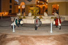 Vintage italian scooter at fountain area in Portofino Hotel by Universal Studios 2 stock photography
