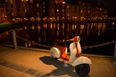 Vintage italian scooter in lake area at Portofino Hotel by Universal Studios 2 stock photography
